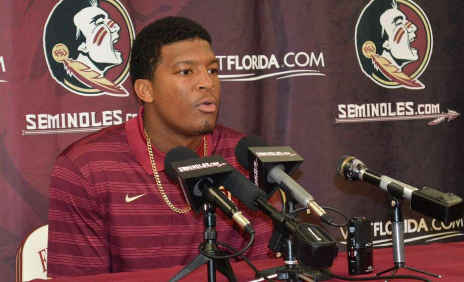 """Heisman Trophy winner Jameis Winston, after being suspended for a half for """"offensive and vulgar"""" comments made on Florida State's campus, said, """"I have to accept the consequences."""" Photo: Bill Cotterell / Associated Press / Tallahassee Democrat"""