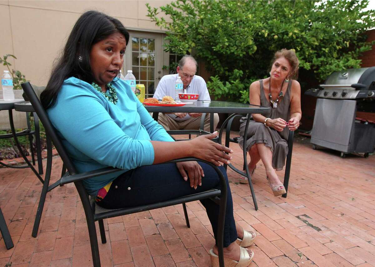 Salvadoran immigrant Esmeralda Bolanos talks to a reporter about her time spent in an immigrant detention center and how Susan Mitchell (right) and her husband, Tom, have helped her in the process of getting released from the facility during a celebratory meal at Refugee and Immigrant Center for Education and Legal Services (RAICES) on Wednesday, Sept. 17, 2014. Bolanos and her two children have been in detention since July 29 and have been separated from her husband and three other children who are living in Colorado.