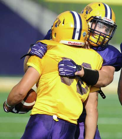 UAlbany linebacker Michael Nicastro, right, makes a tackle during football practice on Wednesday, Sept. 17, 2014 in Albany, N.Y. (Lori Van Buren / Times Union) Photo: Lori Van Buren / 10028658A