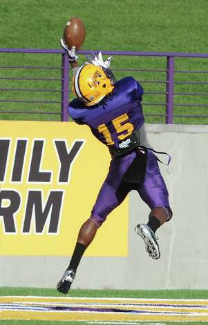 UAlbany safety Rayshan Clark jumps up to catch the ball during football practice on Wednesday, Sept. 17, 2014 in Albany, N.Y. (Lori Van Buren / Times Union) Photo: Lori Van Buren / 10028658A