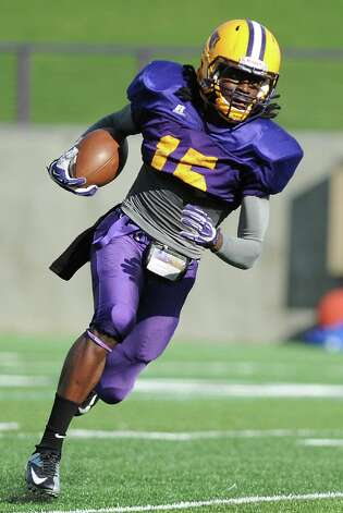 UAlbany safety Rayshan Clark runs with the ball during football practice on Wednesday, Sept. 17, 2014 in Albany, N.Y. (Lori Van Buren / Times Union) Photo: Lori Van Buren / 10028658A
