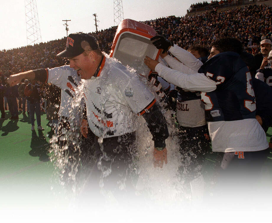 Roosevelt coach Bryan Dausin is drenched after his team beat Flower Mound Marcus for the 1995 Class 5A Division II title. / SAN ANTONIO EXPRESS-NEWS