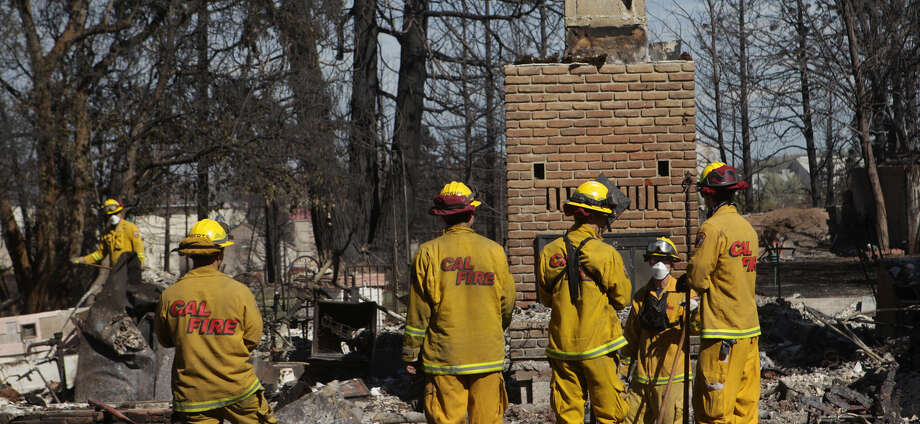 Firefighters were making a house-to-house inspection of properties burned by wildfire in the California community of Weed. One hundred and ten houses were destroyed there. Photo: Andreas Fuhrmann / Redding Record Searchlight / The Record Searchlight