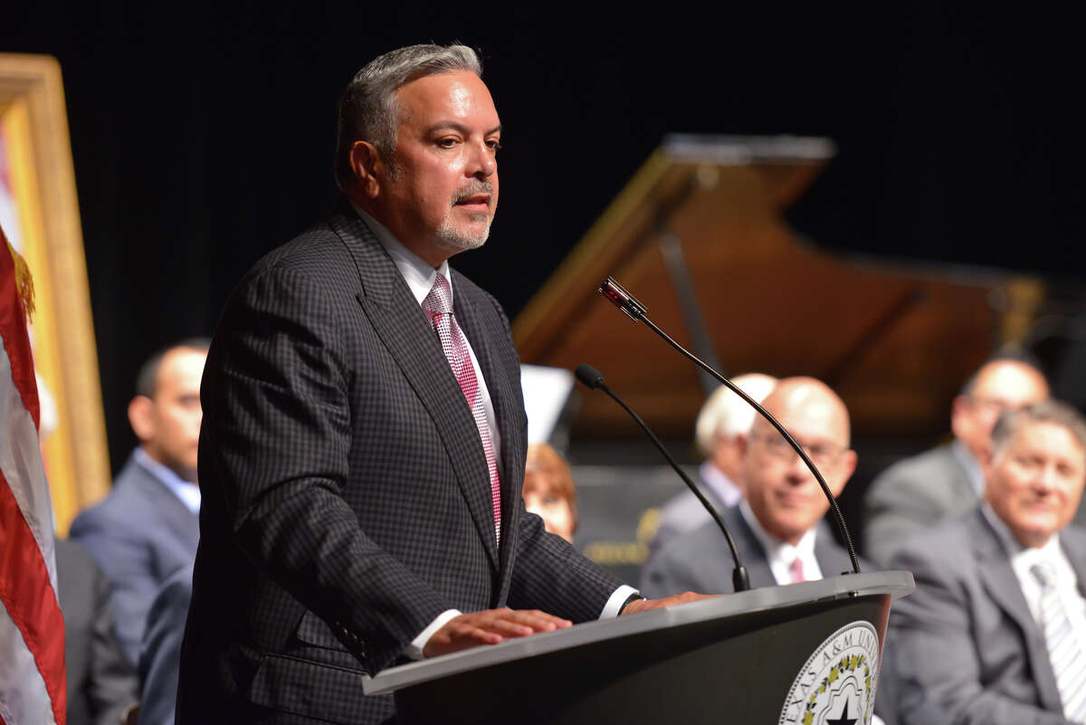 Henry Munoz, Chairman of the Board and COO, Munoz & Company, speaks during the debut ceremonies for the new Central Academc Building at Texas A&M San Antonio Wednesday morning.