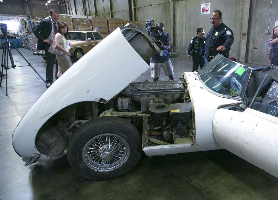 A 1967 Jaguar XK-E convertible that was stolen 46 years ago is shown to the media. Photo: Damian Dovarganes / Associated Press / AP