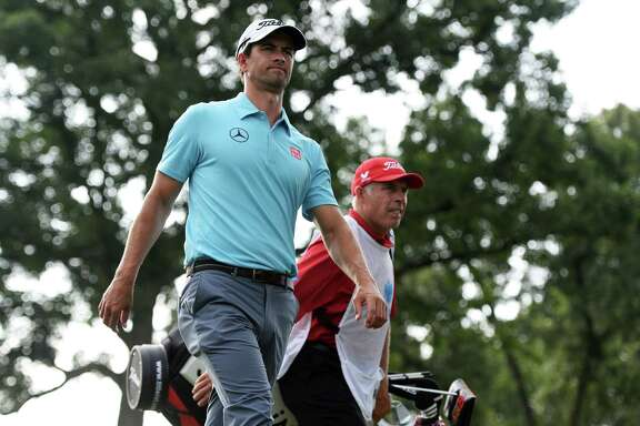 Caddie Steve Williams, background, and Adam Scott are parting ways after a two-year partnership.