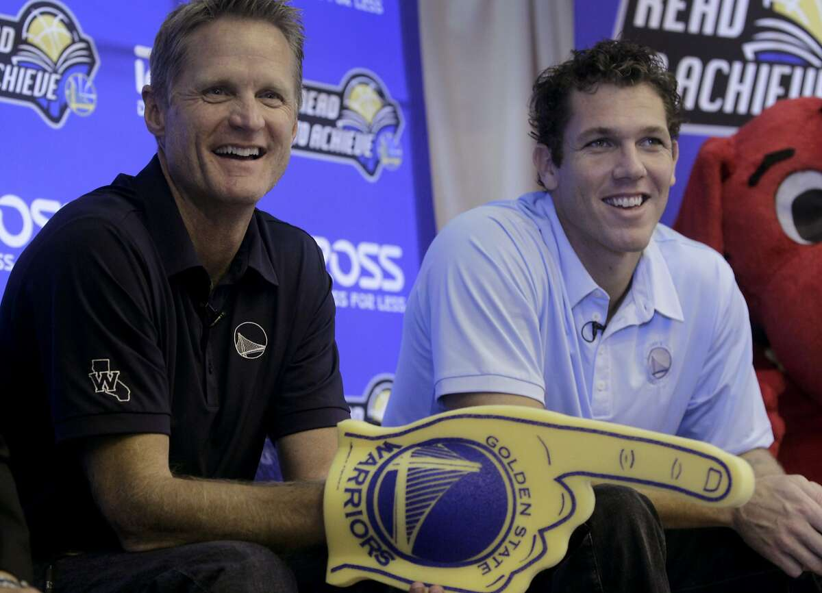 Golden State Warriors head coach Steve Kerr (left) and assistant coach Luke Walton read children's books to students at Longfellow Elementary School in San Francisco, Calif. on Wednesday, Sept. 17, 2014. The event was one of a week-long series of visits to area schools to raise awareness about the importance of education.