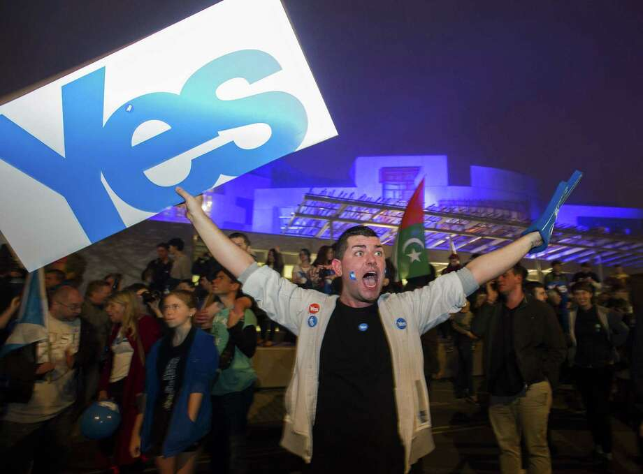 Pro-independence supporters gather Wednesday at the Parliament in Edinburgh, ahead of the referendum on Scotland's independence from the United Kingdom. Photo: Lesley Martin/Getty Images / © Lesley Martin 2014