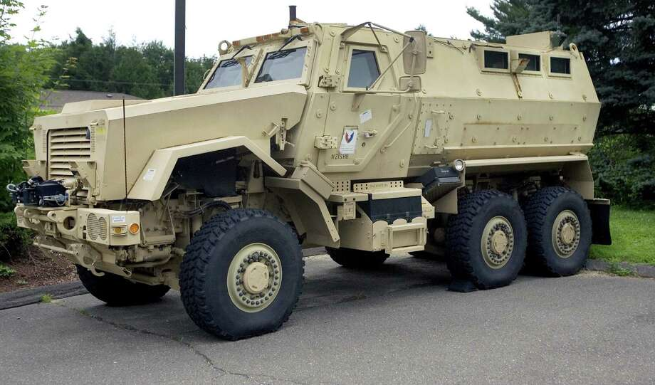 A Mine-Resistant Ambush Protected vehicle sits in front of police headquarters in Watertown, Conn. School police departments have stocked up on free military surplus gear. Photo: Associated Press / File Photo / Republican-American