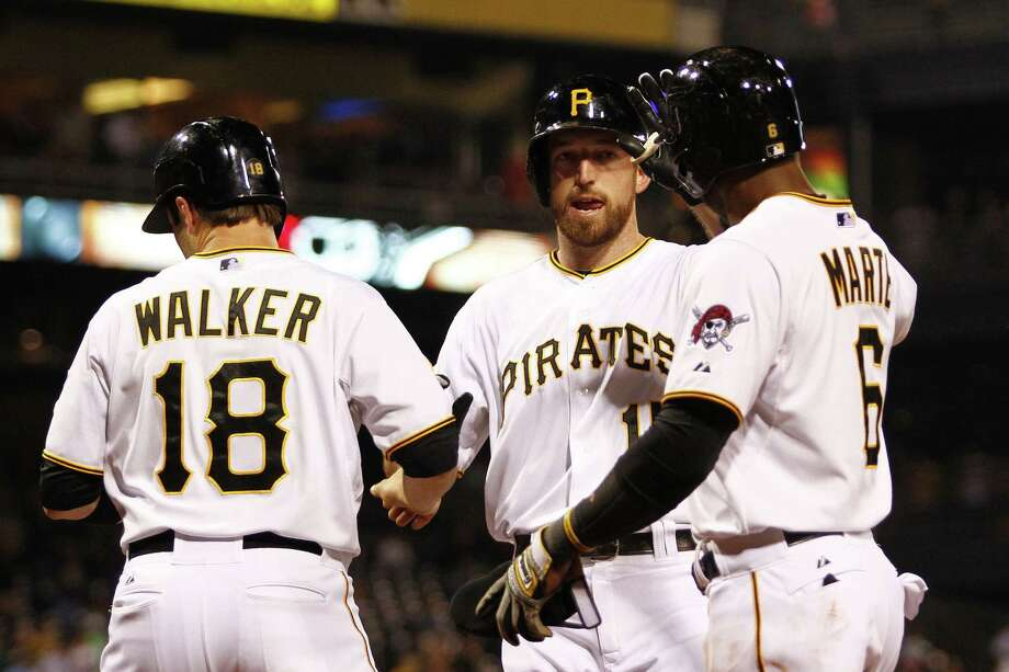 The Pirates' Ike Davis (center) enjoys his three-run homer with Neil Walker and Starling Marte. Photo: Justin K. Aller / Getty Images / 2014 Getty Images