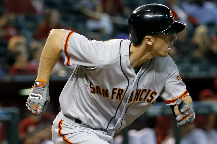 The Giants' Matt Duffy delivered the key two-run pinch-hit single in the ninth to defeat Arizona. Photo: Matt York / Associated Press / AP