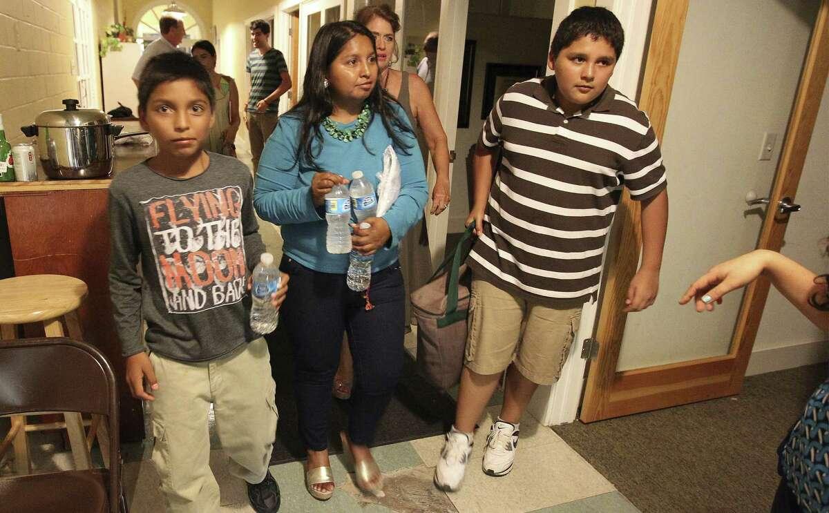 Salvadoran immigrant Esmeralda Bolanos and children Jhonatan (left) and Brian gather for a celebratory meal.
