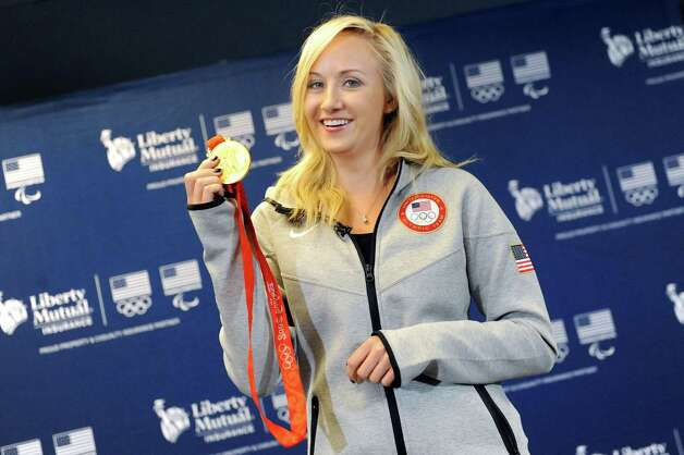 Olympic gold medalist Nastia Liukin holds up the medal she earned in the 2008 Games in Beijing as she speaks on Wednesday, Sept. 17, 2014, at Liberty Mutual in Latham, N.Y. Liukin, now a retired gymnast, continues to support her sport through the annual Nastia Liukin Cup, a national competition that brings the best young gymnasts together. (Cindy Schultz / Times Union) Photo: Cindy Schultz / 10028651A