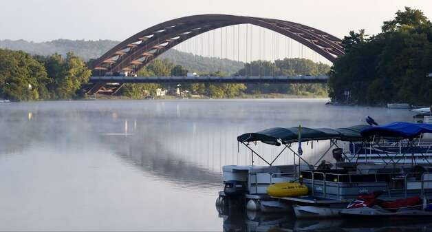 A light mist shows above the water on the Mohawk River near the Twin Bridges viewed from Colonie. (Skip Dickstein/Times Union)