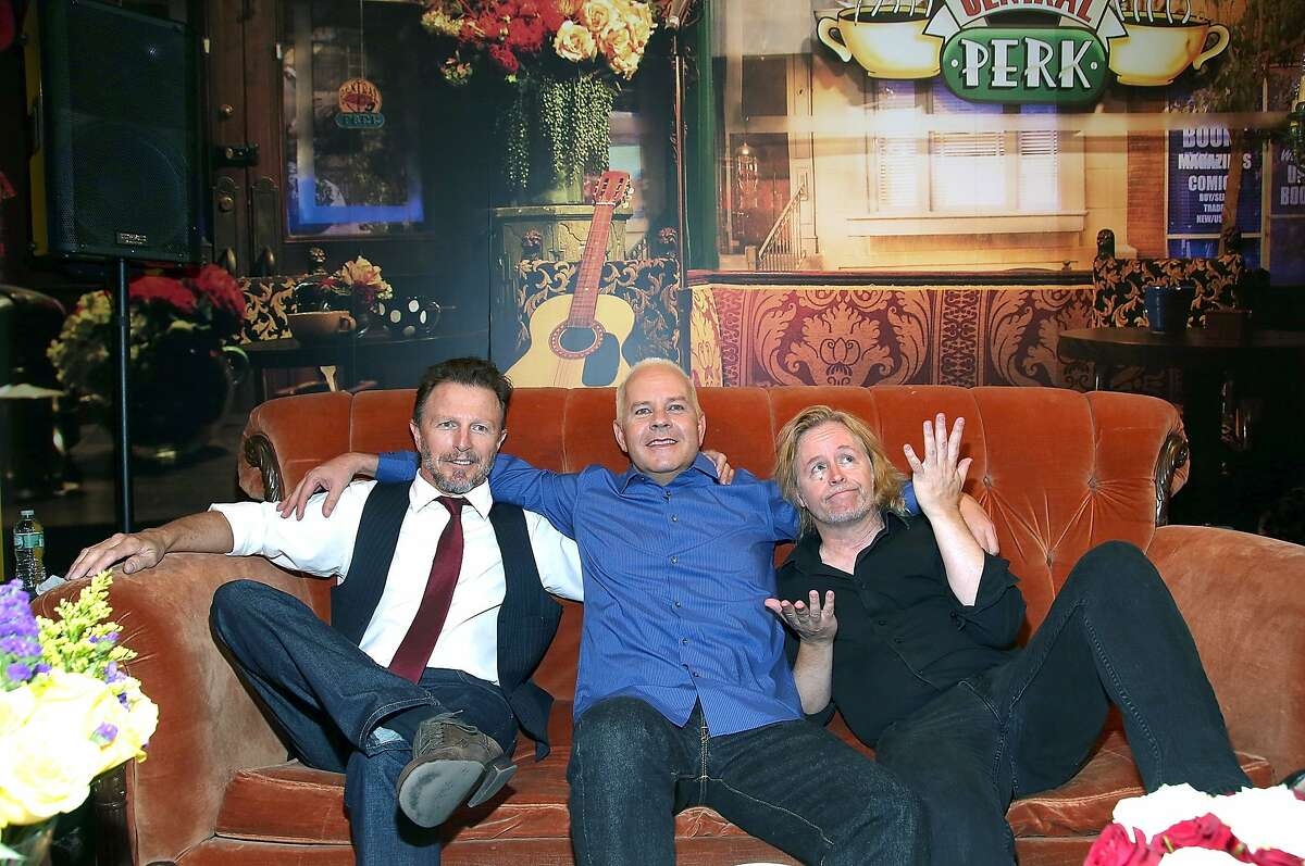 """(L-R) Musician Danny Wilde of band The Rembrandts, actor James Michael Tyler, and musician Phil Solem of band The Rembrandts attend the Central Perk Pop-Up Celebrating The 20th Anniversary Of """"Friends"""" on September 16, 2014 in New York City."""
