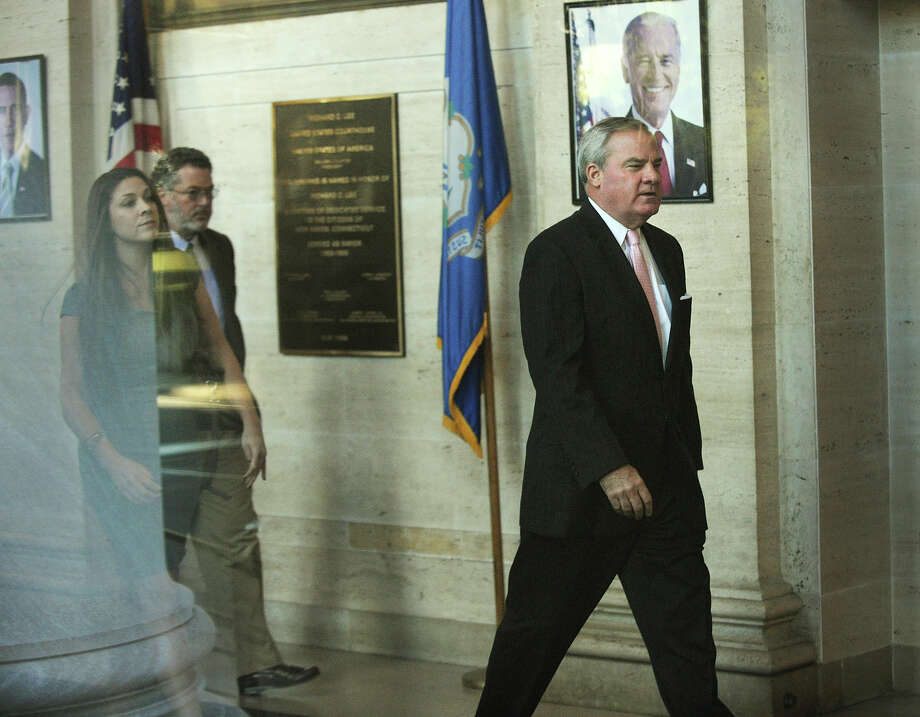 Former Governor John Rowland walks in to Federal Court in New Haven, Conn. on Thursday, September 18, 2014. Rowland faces seven charges of violating federal election laws. Photo: Brian A. Pounds / Connecticut Post