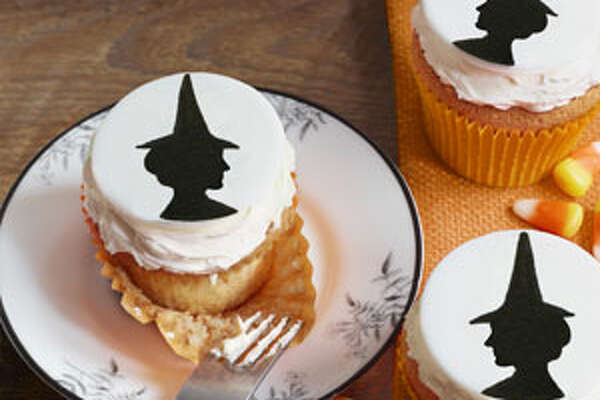 Witch Cupcakes Believe it or not, these silhouettes were created with rubber stamps ($25 for two, Rubber Stamps; 212-675-1180). Using a cookie cutter or a glass, cut fondant into circles and leave out overnight to stiffen. Paint a clean rubber stamp with black food coloring and press image onto the circles. If needed, fill in bare spots with a small paintbrush dipped in food coloring. Just before serving, place the circles on top of cupcakes with buttercream frosting. Note: Fondant is available, in various colors, at craft stores likes Michaels and Jo-Ann. For these cupcakes, microwave it for 8 to 10 seconds, then roll out to 1/4-inch thickness. 50 Best Ways To Use Mason JarsThe 22 Most Incredible Old Houses in Movies13 Moonshine Recipes You Need To Make NowThe Best Paint Colors Right Now12 Design Ideas For A Colorful Retro Kitchen
