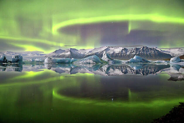 Aurora over a Glacier Lagoon byJames Woodend (UK)*A vivid green overhead aurora pictured in Iceland' /><span></span></a></div>  