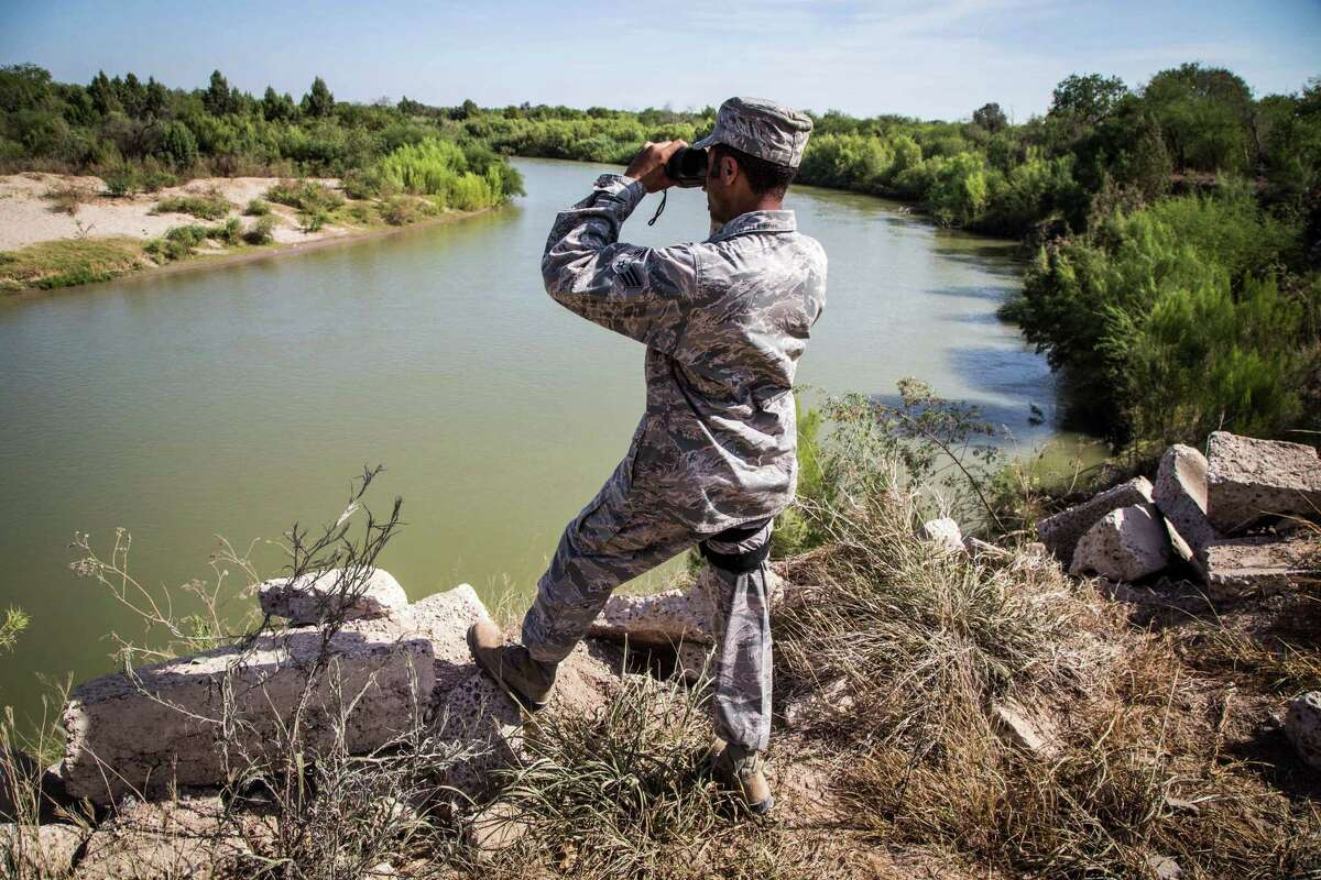 An airman from the Texas Air National Guard observes a section of the Rio Grande River. The airman is serving at the Texas-Mexico border in support of Operation Strong Safety. (U.S. Army photo by Maj. Randall Stillinger)