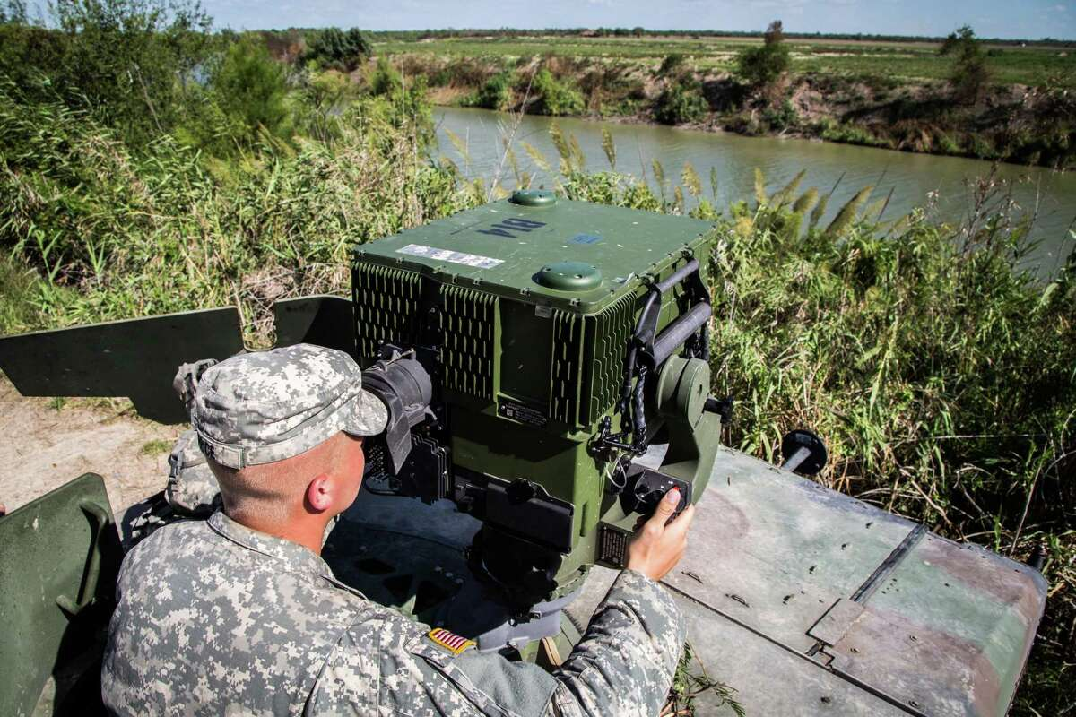 A soldier from the 36th Infantry Division, Texas Army National Guard observes a section of the Rio Grande River utilizing specialized equipment. He is serving at the Texas-Mexico border in support of Operation Strong Safety. (U.S. Army photo by Maj. Randall Stillinger)