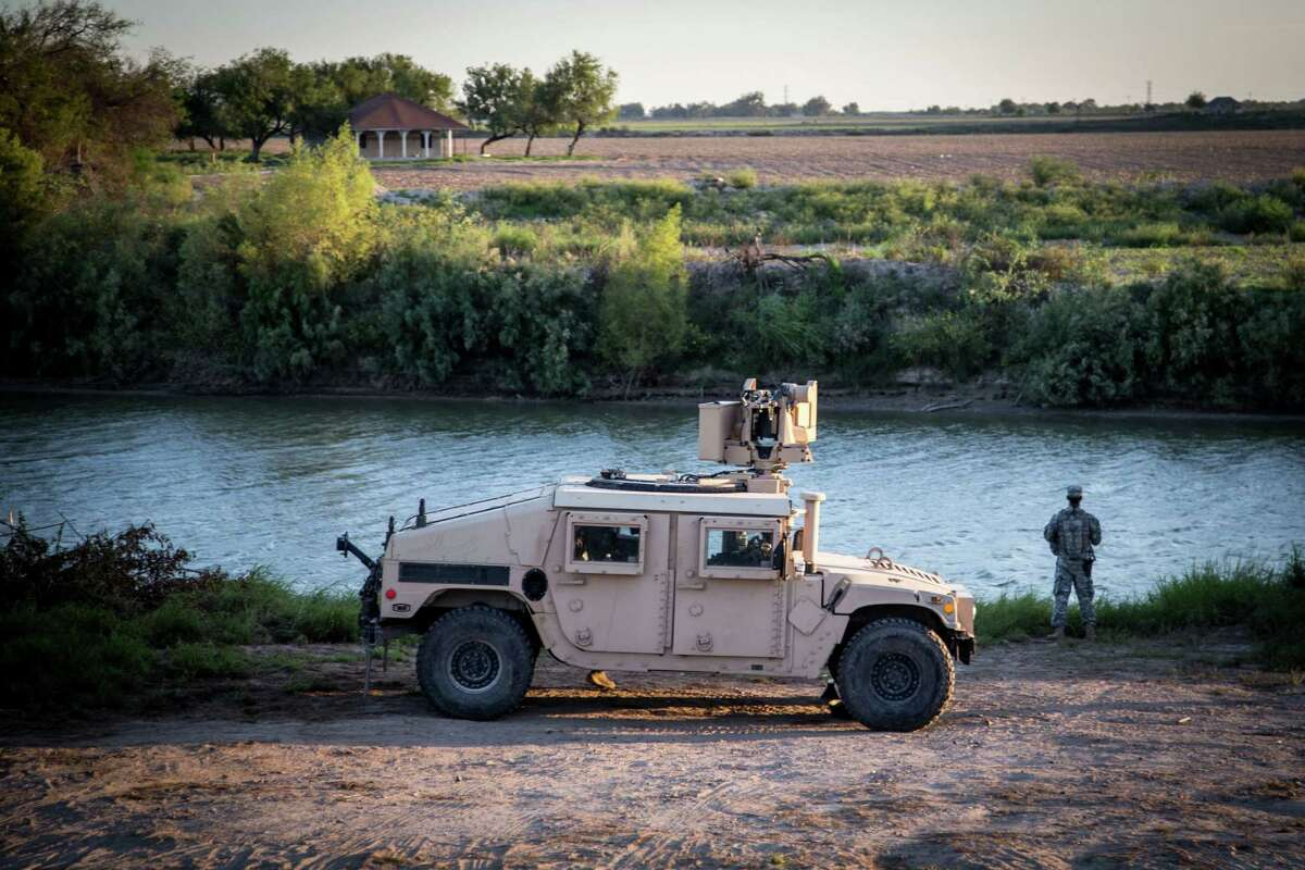A soldier from the 36th Infantry Division, Texas Army National Guard observes a section of the Rio Grande River at sunset. He is serving at the Texas-Mexico border in support of Operation Strong Safety. (U.S. Army photo by Maj. Randall Stillinger)