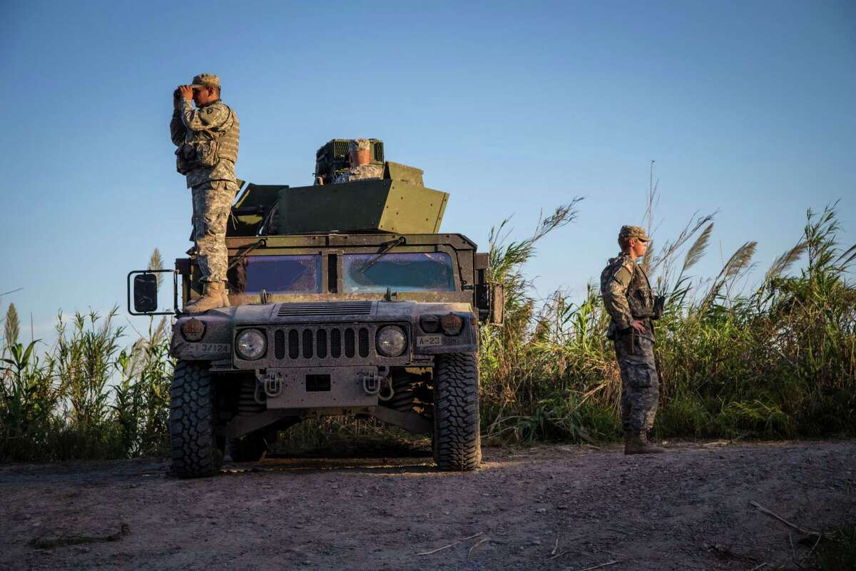 Soldiers from the 36th Infantry Division, Texas Army National Guard observe a section of the Rio Grande River at sunset. The soldiers are serving at the Texas-Mexico border in support of Operation Strong Safety. (U.S. Army photo by Maj. Randall Stillinger)