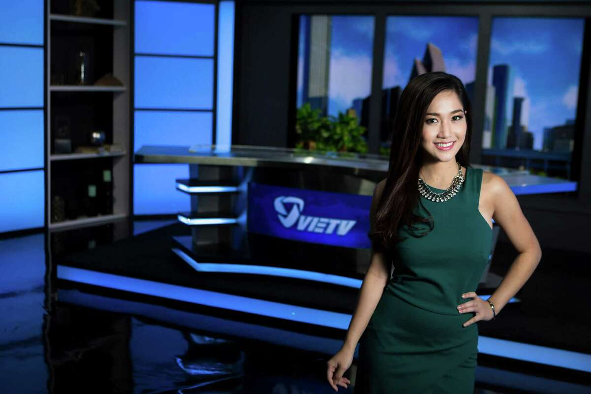 Right after arriving to the United States from Vietnam with the intention of going to school, Kieu Tram got a job as an anchor for VIETV news programming. Now she is both a student and a newswoman who is also tapping into the beauty market. Thursday, Aug. 28, 2014, in Houston. ( Marie D. De Jesus / Houston Chronicle )