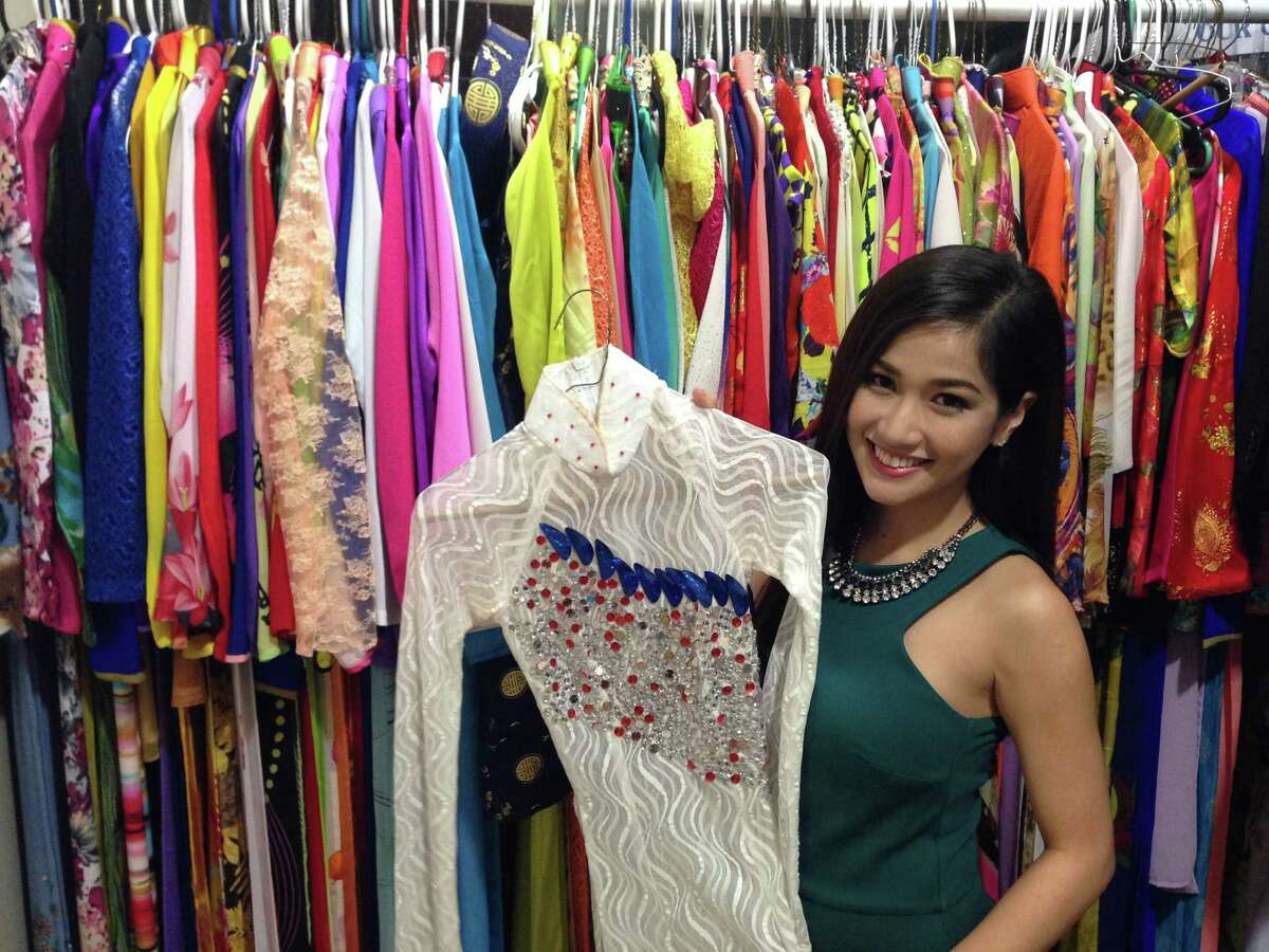 STYLE PROFILE: Kieu Tram, a news anchor with the Houston-based Viet TV, shows her wardrobe of traditional Vietnamese dresses, called é¡o dé, which she wears on air.