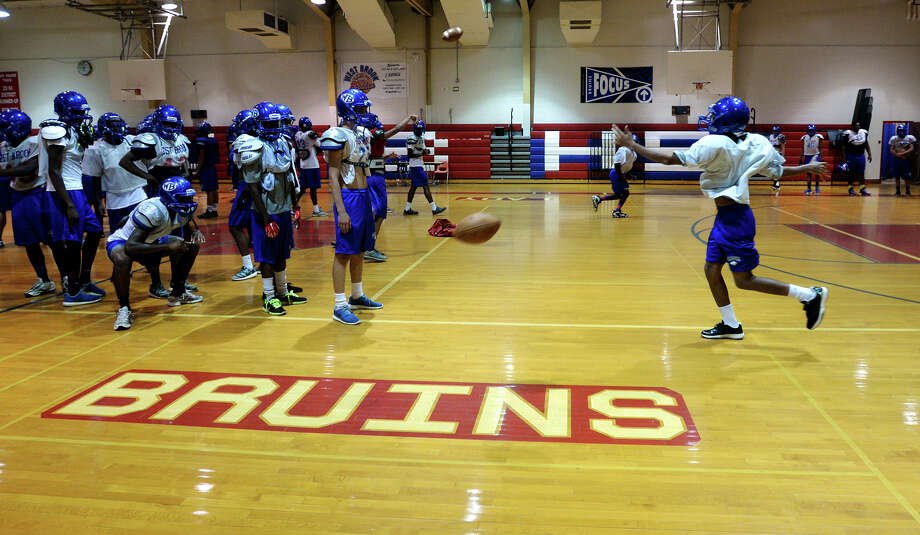 The Bruins run through drills during practice Wednesday. The West Brook Bruins practiced in the gym Wednesday afternoon due to inclement weather.  Photo taken Wednesday 9/17/14  Jake Daniels/@JakeD_in_SETX Photo: Jake Daniels / ©2014 The Beaumont Enterprise/Jake Daniels