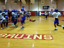 The Bruins run through drills during practice Wednesday. The West Brook Bruins practiced in the gym Wednesday afternoon due to inclement weather.  Photo taken Wednesday 9/17/14  Jake Daniels/@JakeD_in_SETX