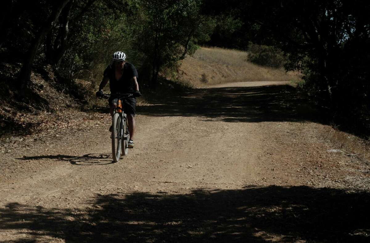 Lester Pinto rides his mountain bike on the trails in the Almaden Quicksilver County Park in San Jose.