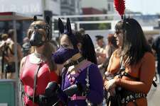 A couple of slave ponies and their master attend the Folsom Street Fair, a world-famous celebration of fetish, leather and S&M, on Sunday in San Francisco.