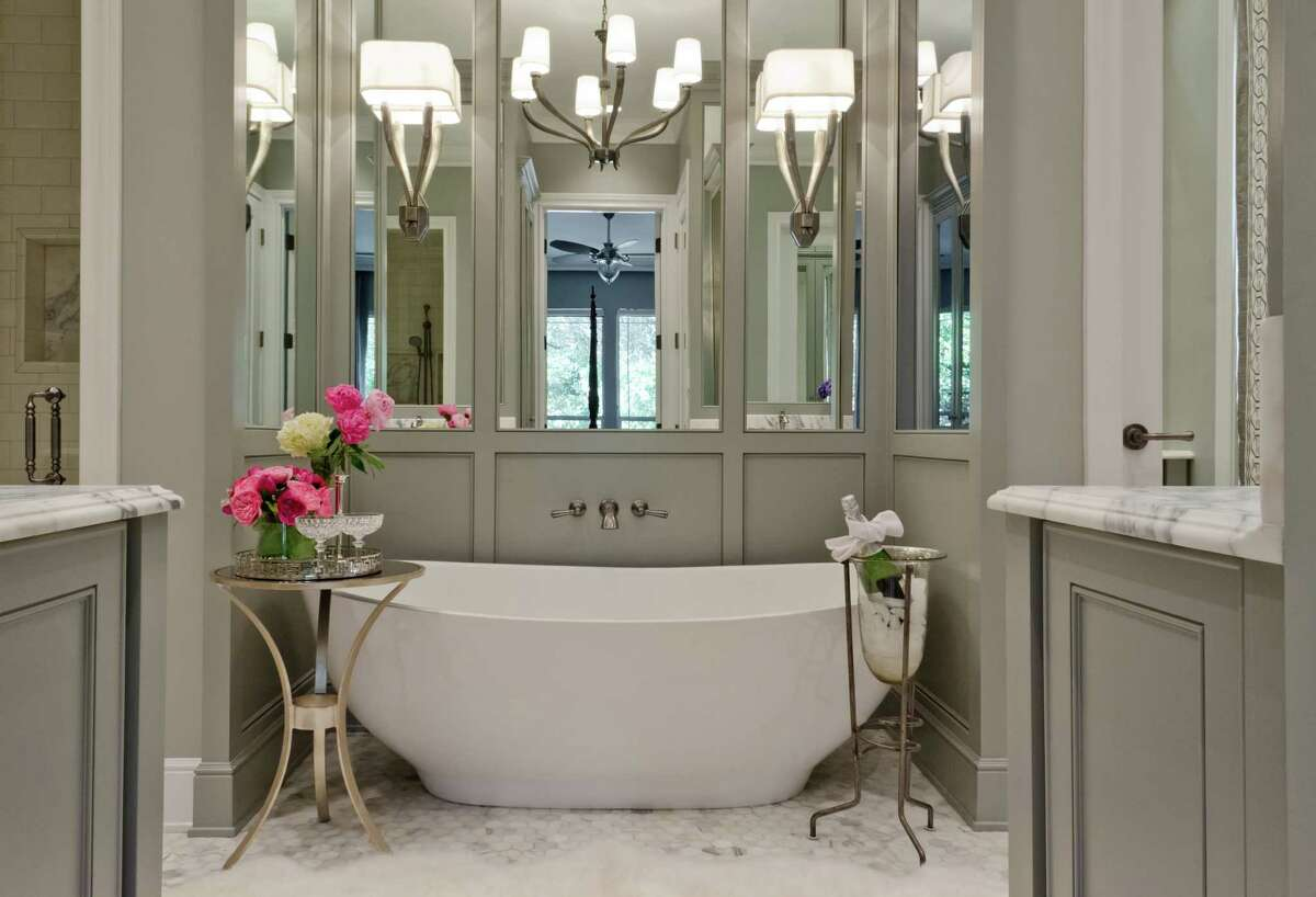 A free-standing tub is the focal point in a clean and serene bath by San Antonio interior designer Julie Bradshaw.