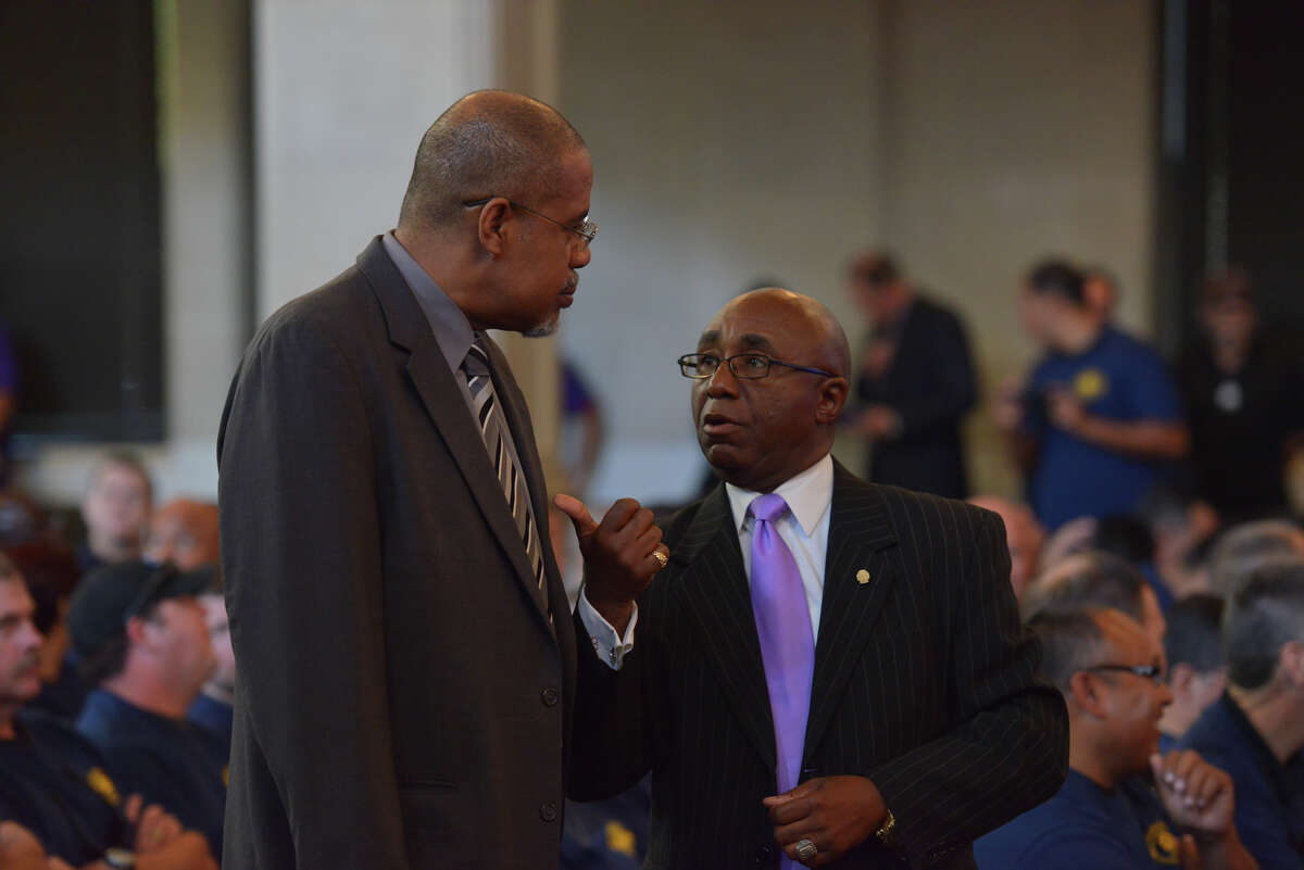 Lester Bryant, (left) a former candidate for the district 2 council seat, talks to councilman Keith Toney Thurs. prior to being appointed to an open seat on the VIA Metropolitan Transit Board.
