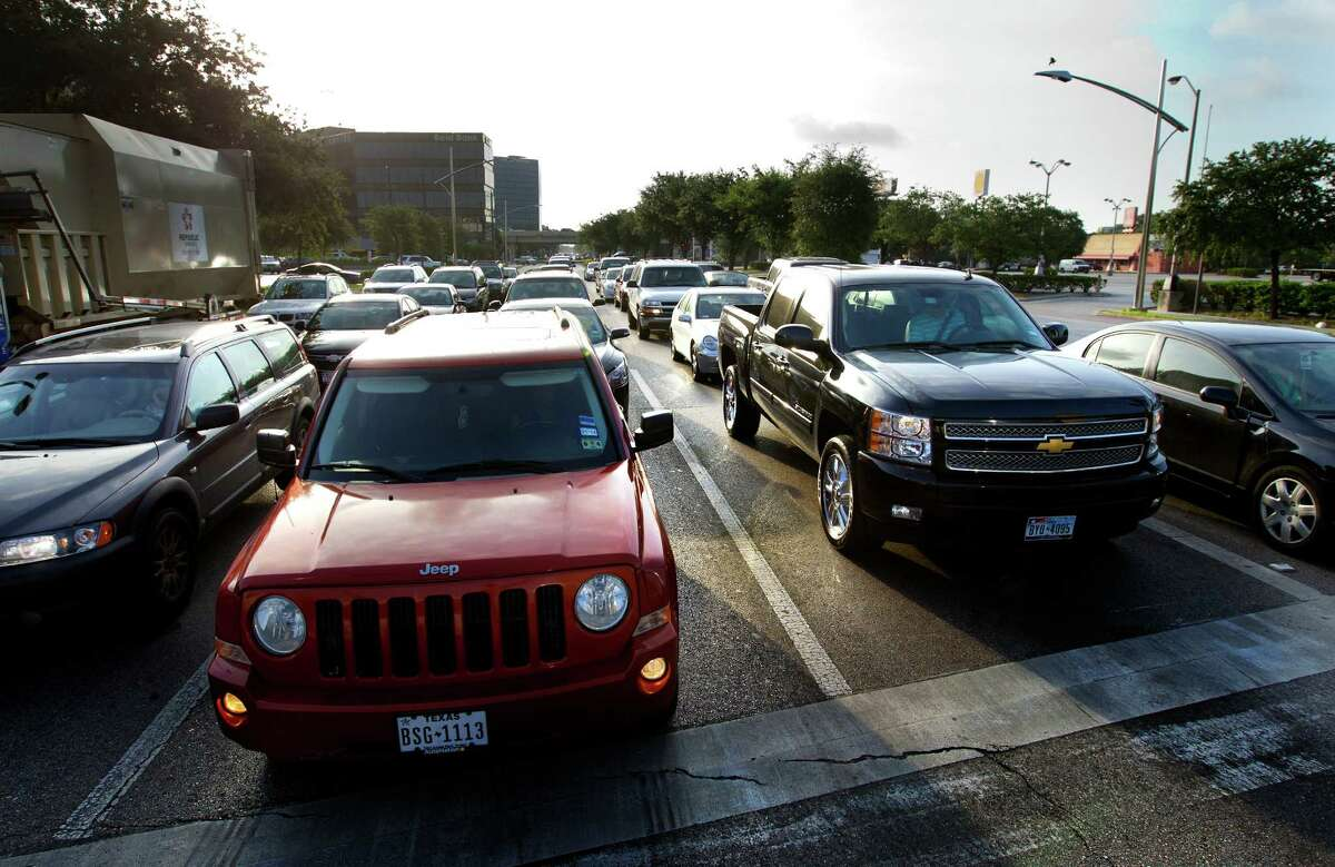 A partnership to build a bus rapid transit system, intended to ease traffic like this in the Uptown area, is fraying. (Cody Duty / Houston Chronicle)