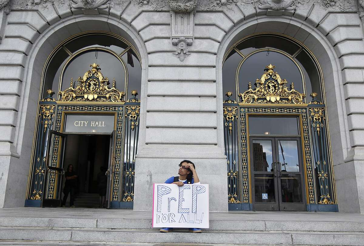 Zachary Robles waits for a rally to start in front of City Hall in San Francisco, Calif. on Thursday, Sept. 18, 2014 to urge citywide distribution of PrEP HIV prevention drugs. Supervisor David Campos will ask for a supplemental appropriation request to seek funding for widespread distribution.