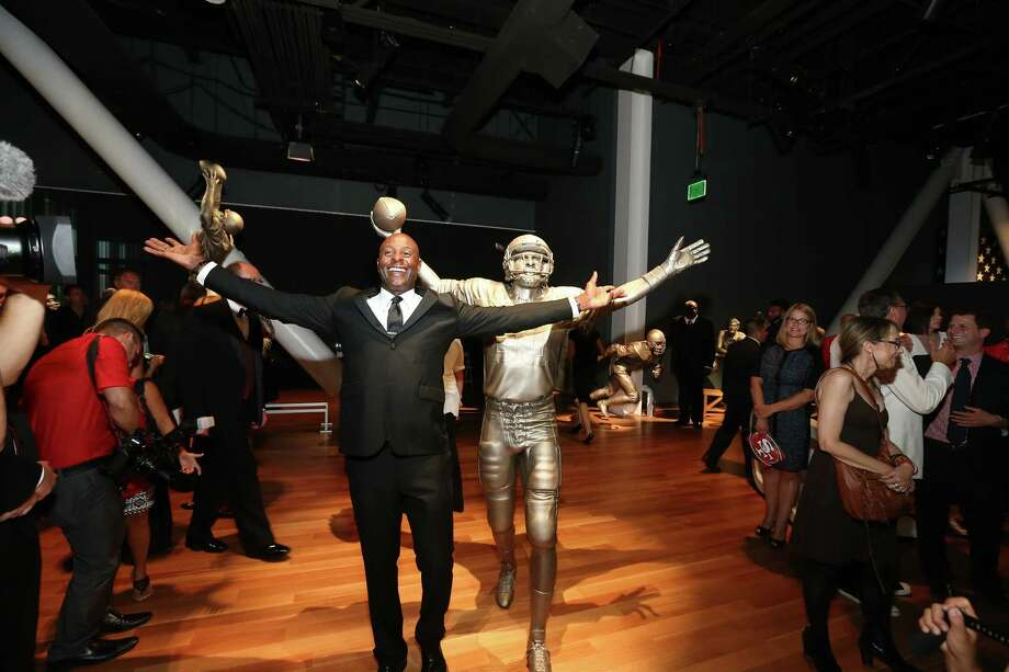 Former 49ers wide receiver Jerry Rice poses with his statue at last week's grand opening of the new 49ers Museum. The museum is located inside Levi's Stadium and is open for tours. Photo: Terrell Lloyd, Courtesy Of The San Francisco 49ers