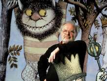 """Author/illustrator Maurice Sendak standing by an life-size scene from his book """"Where the Wild Things Are,"""" at the Children's Museum of Manhattan which is honoring his 50 years of work with an exhibit. Sendak's estate has exercised an option to reclaim some 10,000 drawings from a museum in Philadelphia, to eventually build a museum in Ridgefield, Conn."""