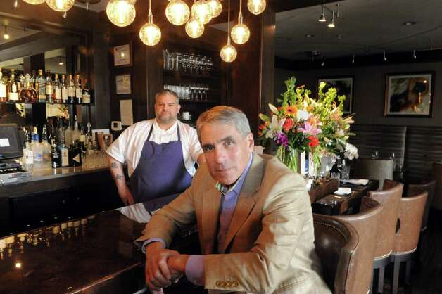 Owner of 15 Church Paul McCullough, front, and Chef Brady Duhame on Wednesday Sept. 10, 2014 in Saratoga Springs, N.Y. (Michael P. Farrell/Times Union) Photo: Michael P. Farrell / 00028541A