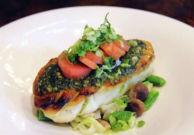 The Chilean seabass with basil pesto and pickled rhubarb entree at 15 Church on Wednesday Sept. 10, 2014 in Saratoga Springs, N.Y. (Michael P. Farrell/Times Union) Photo: Michael P. Farrell / 00028541A