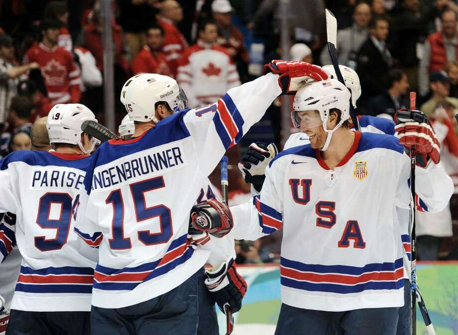 VANCOUVER, BC - FEBRUARY 21: USA players celebrate after they won the ice hockey men's preliminary game against Canada on day 10 of the Vancouver 2010 Winter Olympics at Canada Hockey Place on February 21, 2010 in Vancouver, Canada.  (Photo by Harry How/Getty Images) Photo: Harry How, Getty Images / 2010 Getty Images