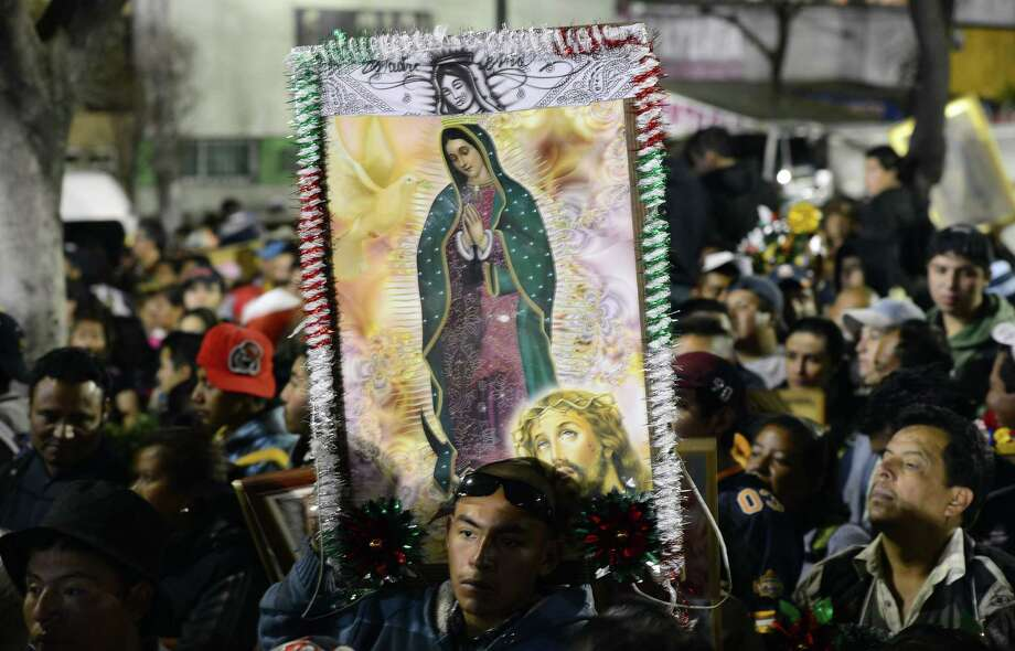Pilgrims hold an image of the Virgin of Guadalupe   in Mexico City. A reader carried an image of the Virgin in his billfold, and it was its loss that caused him the most sorrow. His story has a happy ending. Photo: Alfredo Estrella / Getty Images / ALFREDO ESTRELLA