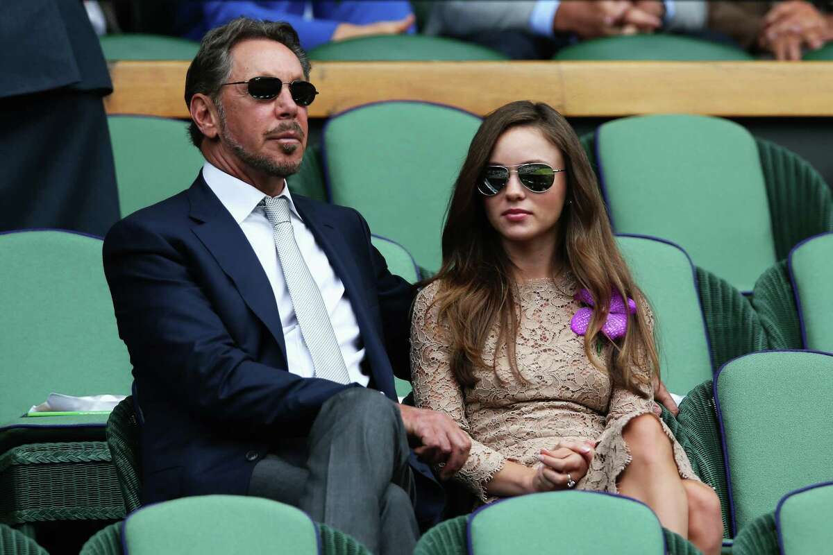Larry Ellison and Nikita Kahn sit in the Royal Box on Centre Court before the Gentlemen's Singles Final match between Roger Federer of Switzerland and Novak Djokovic of Serbia on day thirteen of the Wimbledon Lawn Tennis Championships at the All England Lawn Tennis and Croquet Club on July 6, 2014 in London, England.