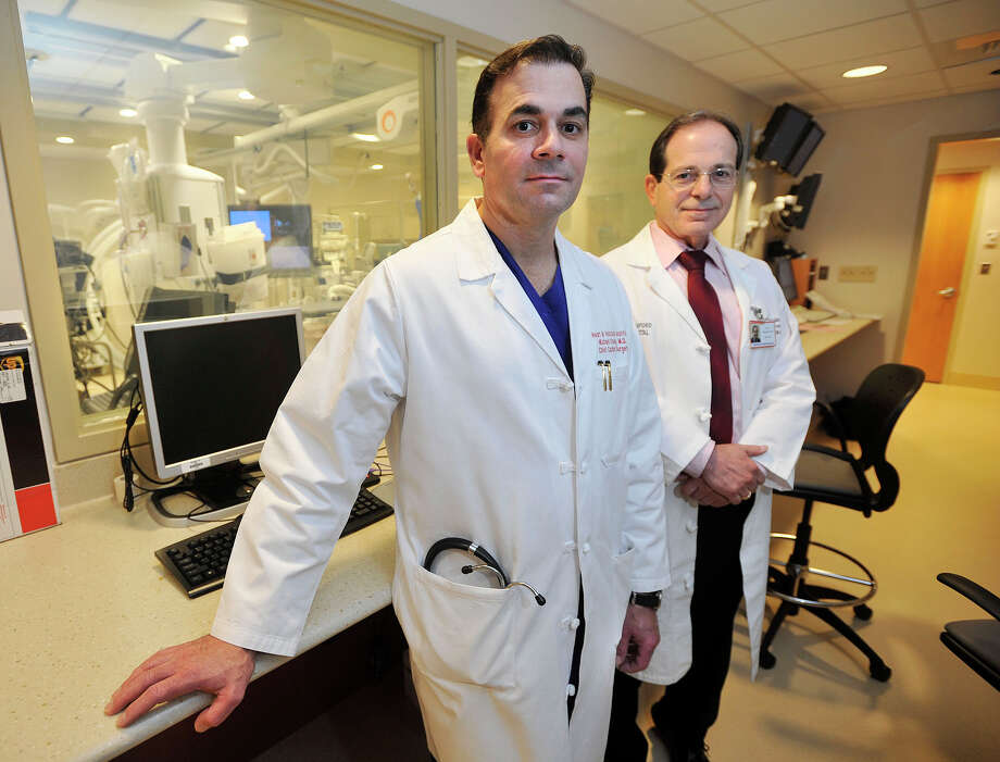 Dr. Michael Coady MD, left, chief of cardiac surgery, and Dr. Steve Horowitz MD, interim chief of cardiology, pose in the electrophysiology biplane lab at Stamford Hospital in Stamford, Conn., on Thursday, Aug. 28, 2014. Photo: Jason Rearick / Stamford Advocate