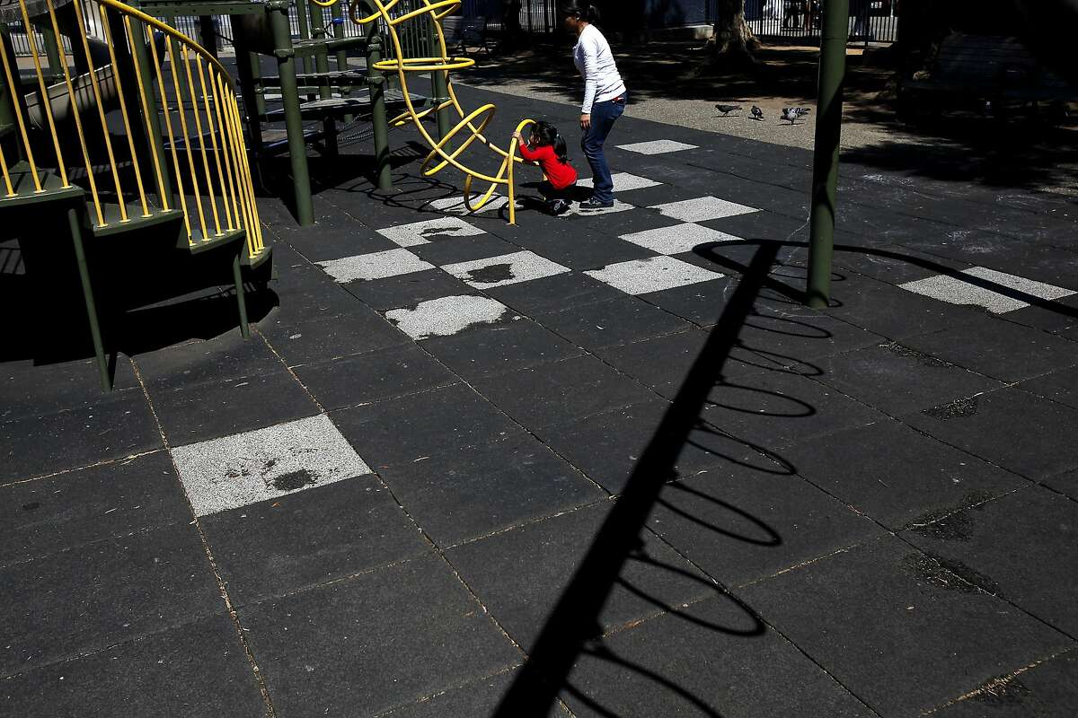 Yuliana Hernandez-Ramos, 2, and her mom Linda Ramos play at the playground at Civic Center in San Francisco, Calif., on Tuesday, September 16, 2014. The Helen Diller Foundation has agreed to pump $5 million of private money into revamping the playground in front of City Hall. They live in the neighborhood and Linda said she used to play at the playground when she was a kid.
