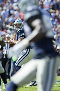 NASHVILLE, TN - SEPTEMBER 14:  Tony Romo #9 of the Dallas Cowboys looks downfield for a receiver during a game against the Tennessee Titans at LP Field on September 14, 2014 in Nashville, Tennessee.  The Cowboys defeated the Titans 26-10. Photo: Wesley Hitt, Getty Images / 2014 Getty Images