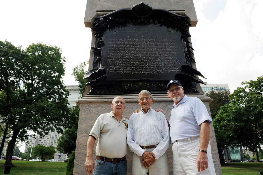Joe Pollicino, left, Charlie Johnson, center, and Kevin Hicks pose with the Albany County Vietnam Veterans Monument on Wednesday, Aug. 20, 2014, at Lafayette Park in Albany, N.Y. (Cindy Schultz / Times Union) Photo: Cindy Schultz / 00028263A