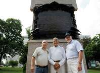 Joe Pollicino, left, Charlie Johnson, center, and Kevin Hicks pose with the Albany County Vietnam Veterans Monument on Wednesday, Aug. 20, 2014, at Lafayette Park in Albany, N.Y. (Cindy Schultz / Times Union)