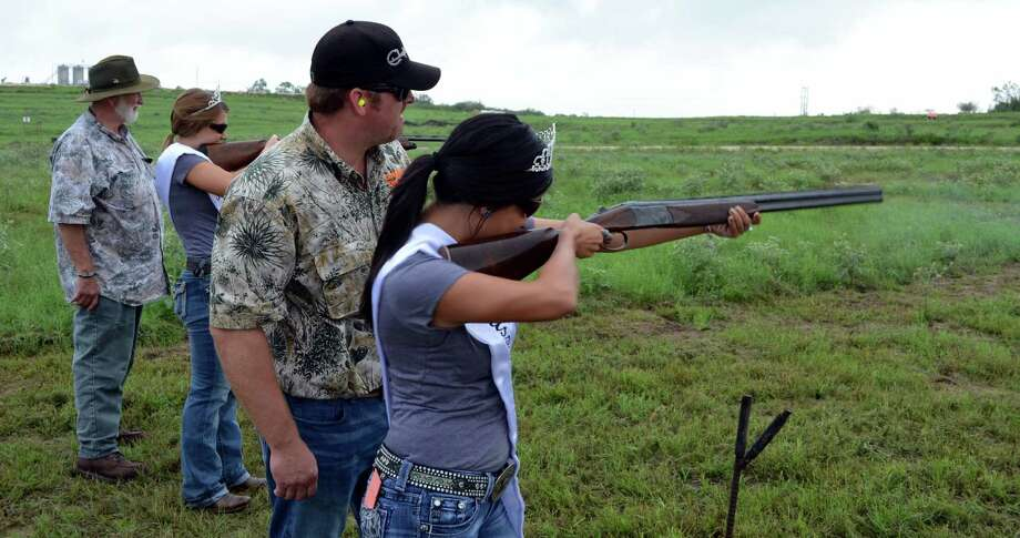 The Karnes County Lonesome Dove Fest royalty receive a little hands-on shotgun training during last year's youth day. Photo: Photos By Ralph Winingham / For The Express-News