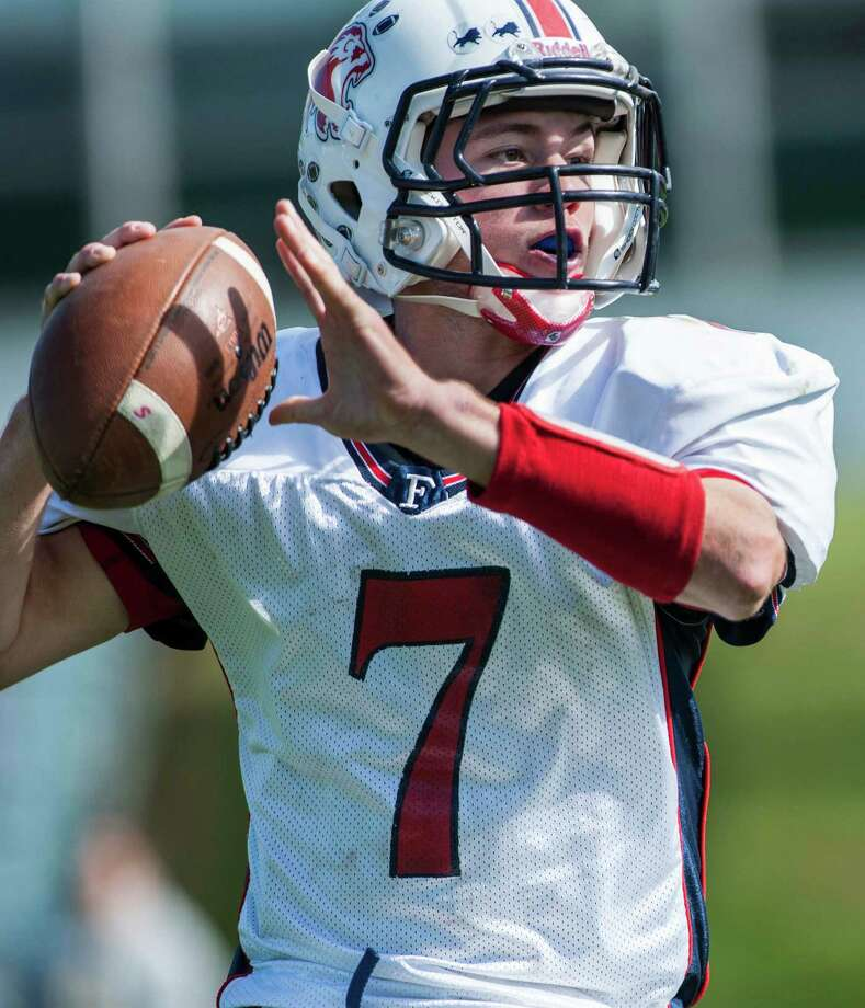 Foran high school quarterback Jake Kasuba looks downfield for a receiver during a football game against Trinity Catholic high school played at Trinity in Stamford, CT on Saturday, October, 12th, 2013 Photo: Mark Conrad / Stamford Advocate Freelance